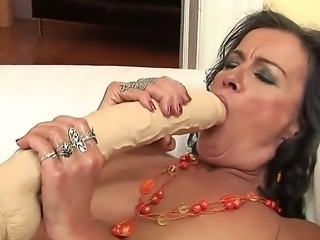 Im Sandora, and I love to find some young babes to satisfy my hunger. This time I got to know Betty Stylle who was more than happy to help me out... after playing with my dildo.