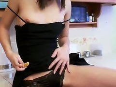 Sweet lady with pretty face Nikita gets in herself orange juicy and masturbates