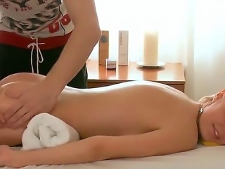 Perfect skinned babe Ema surprises this handsome masseur with her elegant naked forms