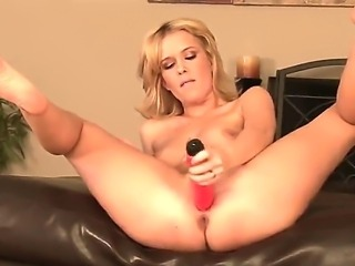 The fantastic blonde Sasha Knox with a medium coconuts penetrates her vagina...