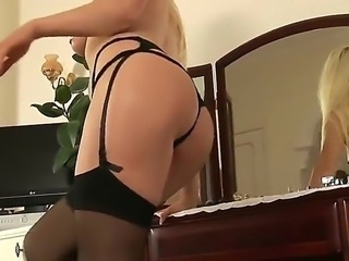 Steaming hot blonde Alexis Jade in arusing black lingerie and high heels...