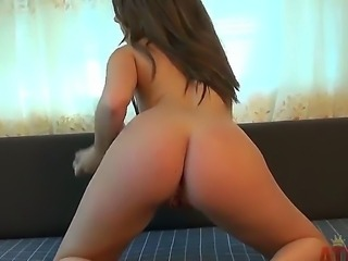 Turned on long haired brunette beauty Cali Hayes with natural boobs and sexy body in black undies and high heels stuffs her wet minge with glass dildo to orgasm in close up.