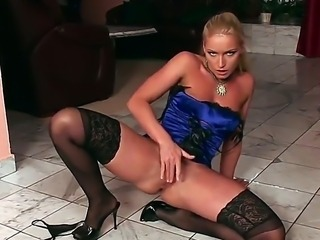 Dangerous blonde vixen Caty Campbell caressing hard her naughty pussy in sexy corset
