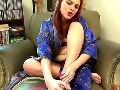 Cute redhead slender girl Andrea Skye excitingly taking off her sexy robe ant...