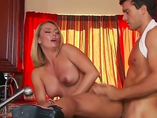 Mature blond Brenda James teases and  lets younger stud Ramon to ravage her tight pussy