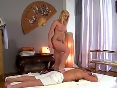 Beautiful blonde woman Kathia Nobili is becoming absolutely nude and then starts massaging back of her handsome boyfriend using her feet only! See the continuation!