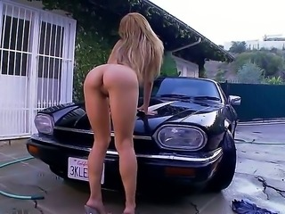 Sexy slut Alexa Nicole want to do something seducing and she decides to wash her boyfriends car absolutely naked. She reveals her giant tits and her firm round ass