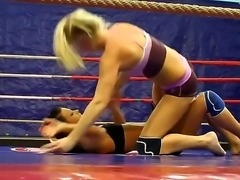 Blonde and brunette topless girls are wrestling in this exciting scene. They...