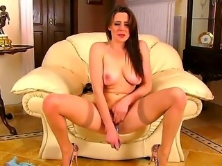 Dark haired and busty pale honey Samantha Bentley enjoys in taking her undies off and playing with her trimmed and really wet pussy on the sofa in the living room for camera.