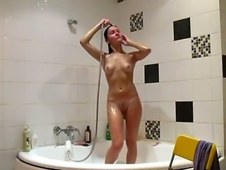 Betsy shaves her legs and sweet pussy in the shower in front of the hidden...