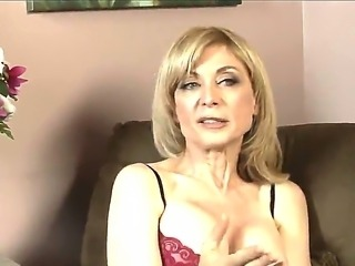 Mature lesbian whore Nina Hartley in sexy lingerie shares her fucking experience on camera!