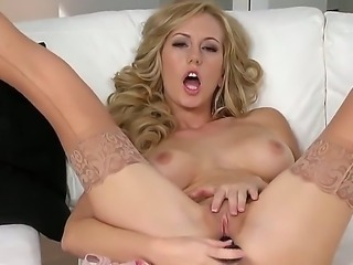Diamond blondie in sexy stockings is drilling her shaved pink pussy with a dildo