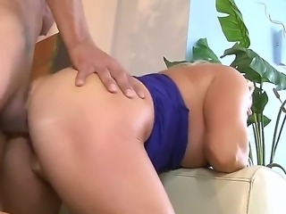 Arousing and sexy golden haired Alexis Diamond with large boobs gets bent over in doggy pose and slammed up her tight ass hole really good and hard on the couch