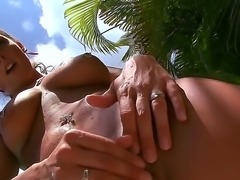 Buxom tattooed vixen Krystal Main spreads her pussy on the camera and gets...
