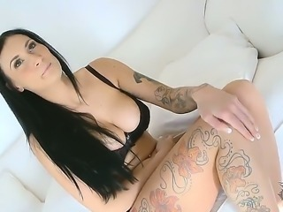 Brunette chick Isla demonstrates her sexy tattooed body and it looks really awesome