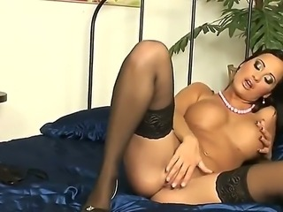 The glamorous fashion model Claudia Capri in black stockings masturbates her shaved pussy
