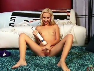 Superb blonde teen Odette Delacriox enjoys massive vibrator sliding over her shaved clit