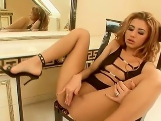 Vanity fair. Staring Crystal Crown. This blonde chick cant stop looking at herself in the mirror. She gets turned on as she watches herself standing there in her sexy lingerie as she sticks her fingers deep into her hot wet pussy.