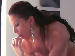 Cute brunette with trimmed pussy penetrates her ass deep with her fingers
