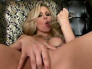 The gorgeous MILF pornstar Julia Ann penetrates her sweet shaved pussy with a...