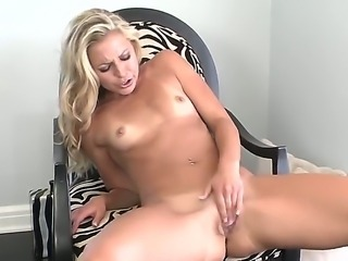 The gorgeous blonde Lena Nicole with the gentle body masturbates her pussy on...