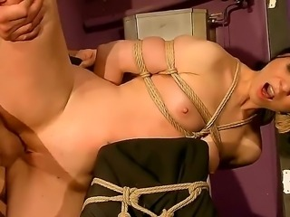 Watch as Alice is tied to the doorway of the leaky bathroom and is made to...