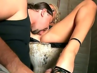 Hungry stud is licking Brittany Springs sexy feet zealously before she gives him a wild foot job