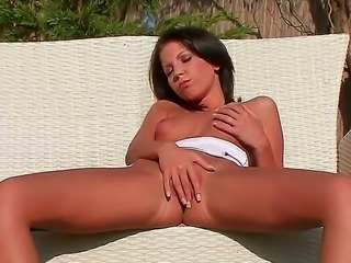 Cute brunette girl with nice forms of body looks adorable and she is going to...