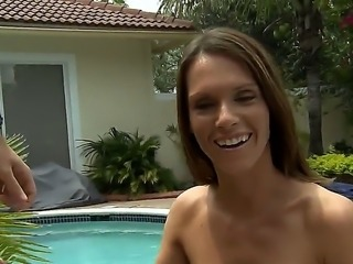 Jennifer Dark gets deep fucked after sucking on a huge dick over by the pool side