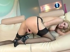 Young blonde Carli Banks in hot stockings poses on the camera showing tight...