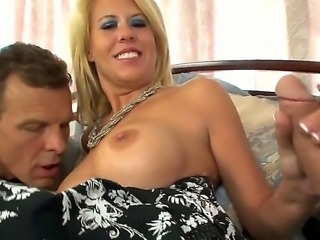 Grace Evangeline is a sexy milf secretary. She enjoys lunch-break fucking with her rich boss in the office, but today he prepared her a special present - he called his son to fuck band her holes.