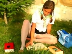 Teen college chick Mary loves to read book, especially sitting on the green...