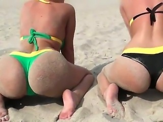 Two awesome blonde and brunette pornstars Molly Cavalli and Sinn Sage play on a beach