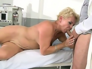 Horny blonde granny with nice body sucks cock like a tasty candy bringing a...