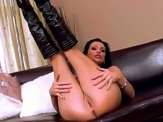 Naughty chick Aletta Ocean showing off her precious fake boobs and tight shaved cunt, she is passionately fingering her pussy and sucking that fingers!