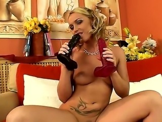Kathia Nobili demonstrates how she likes to play with her two powerful dildos