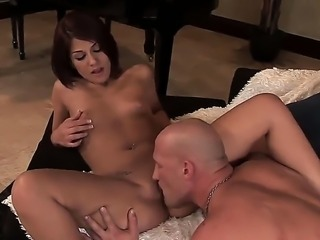 Sexy redhead Dahlia Denyle meets hot man with huge dick and willingly starts the action. She presents him exciting blowjob and gets fucked hot in the pussy.