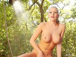 A super sexy blonde with some of the biggest balloon shaped tits Ive seen in a while fingers herself silly in a beautiful wooded area. Care to watch I thought so. Enjoy.