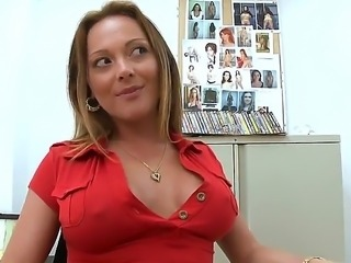 Busty blond milf is stripping in the office and then sticking her vagina with...