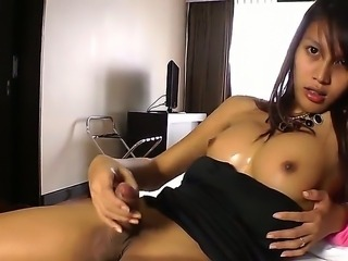 Hot Asian tranny with cute perky boobs is jerking off his huge dick on the bed