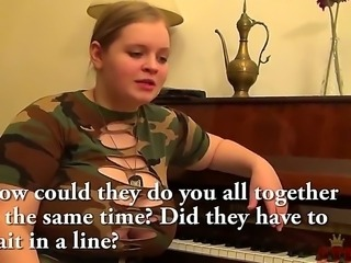 Short but big beautiful blonde teen Yada with enormously big knockers in sexy army t-shirt sits by the piano and talks about her sexual life at the interview with filthy dude.