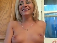 The attractive blonde pornstar Caprice Capone undresses on a kitchen and...