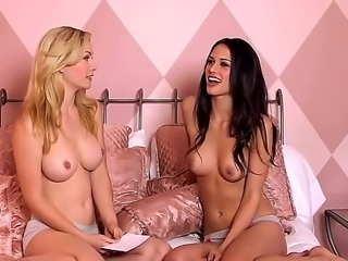 Naughty girls Heather Vandeven and her brunette sexy girlfriend are sitting on the bed topless and showing off their perfect medium size boobies with tiny hot nipples