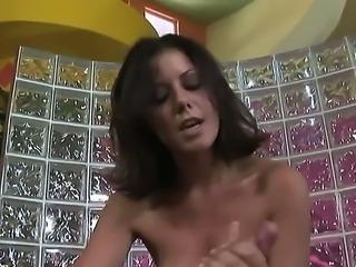 Busty babe Penny Flame enjoys pleasing hunk with amazing handjob session