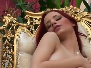 The sympathetic redhead pornstar Ariel penetrates her tight pussy with a...