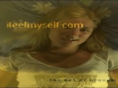 beautiful blonde in lingerie masturbating