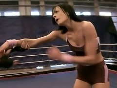 Gorgeous brunette boxing babes have a sensational fight as they play with...