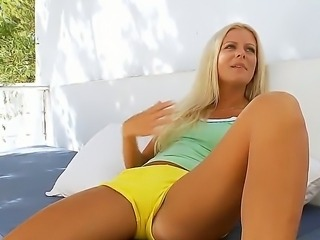 Dont miss an opportunity of having relaxation with this exciting blonde chick. She is giving interview talking naughty during it and showing some parts of cool body.