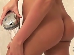 Arousing blonde hottie Veronica da Souza likes masturbating while having warm showers