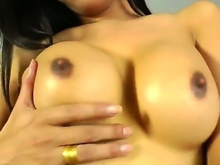 Slutty sexy horny model brunette Paula B shemale enjoys striking her massive...